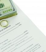 Divorce Form With Stack Of Hundred Dollars Bills