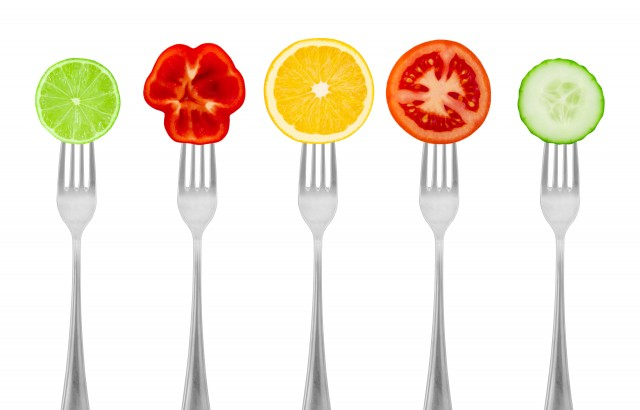 Healthy diet, organic food on forks with vegetables and fruit. Diet concept nutrition.